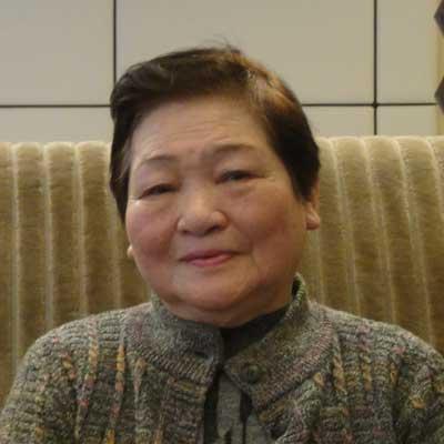 創業者の妻である山下よ志子の顔写真